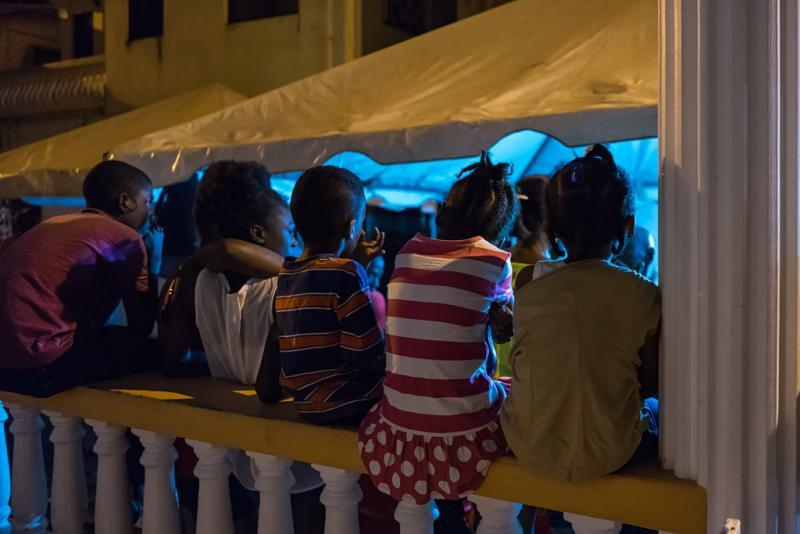 children at gouyave fish fry
